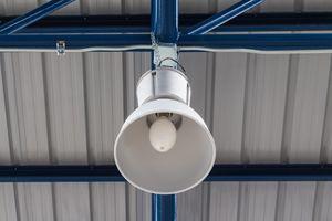 Overhead light hanging on factory truss
