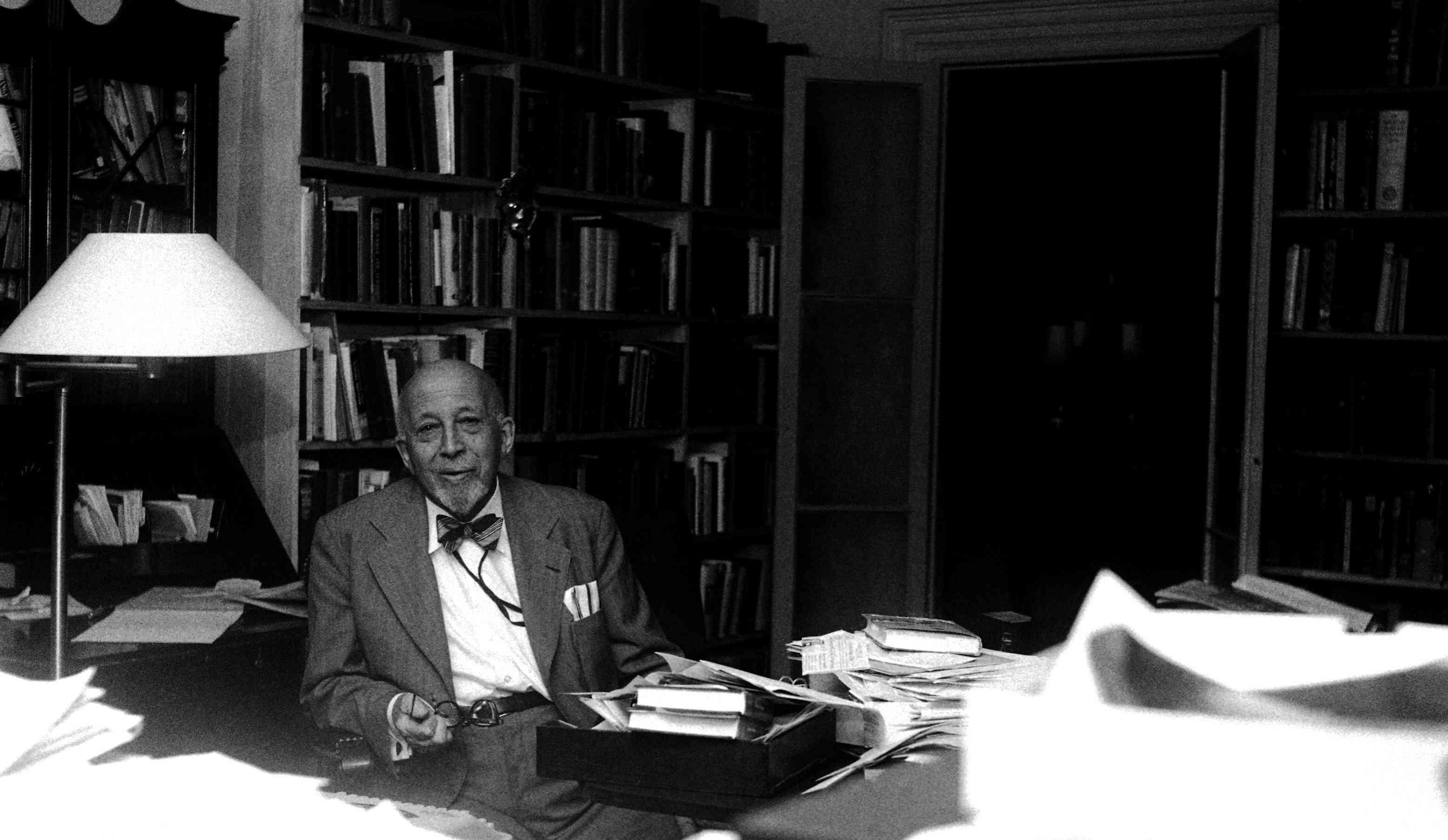 W. E. B. Du Bois sitting at a desk