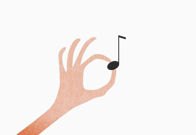 A look at musics middle c note hand holding musical note against white background thecheapjerseys Gallery