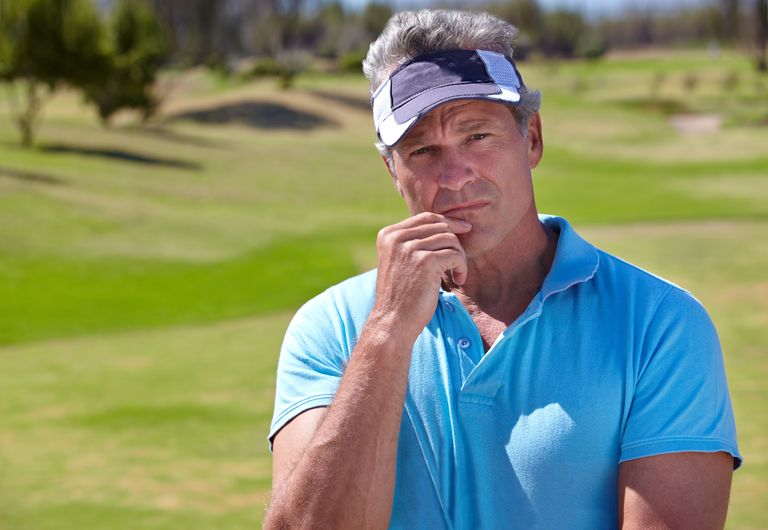Golfer thinking over what shot to play next