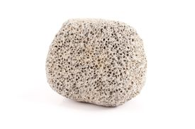 Pumice is a pale, lightweight rock with a foamy porous appearance.