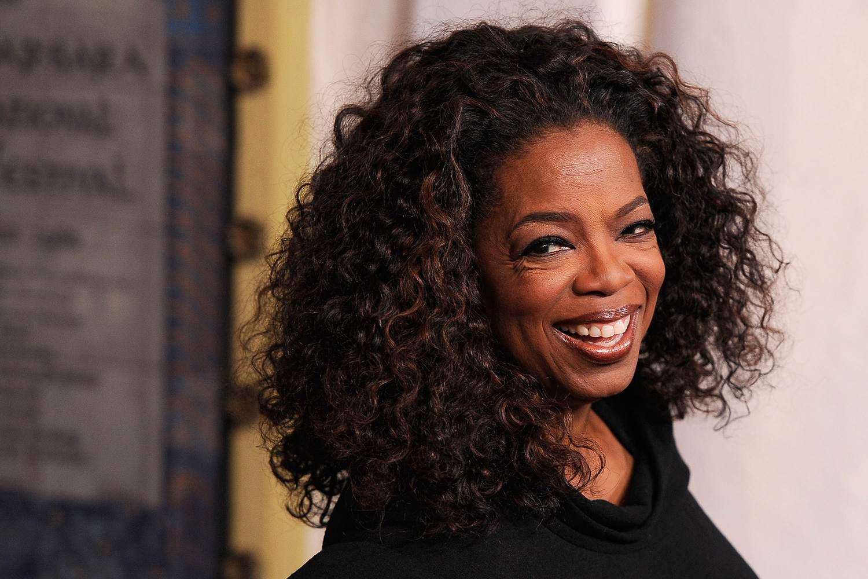 Oprah Winfrey smiling at the camera.