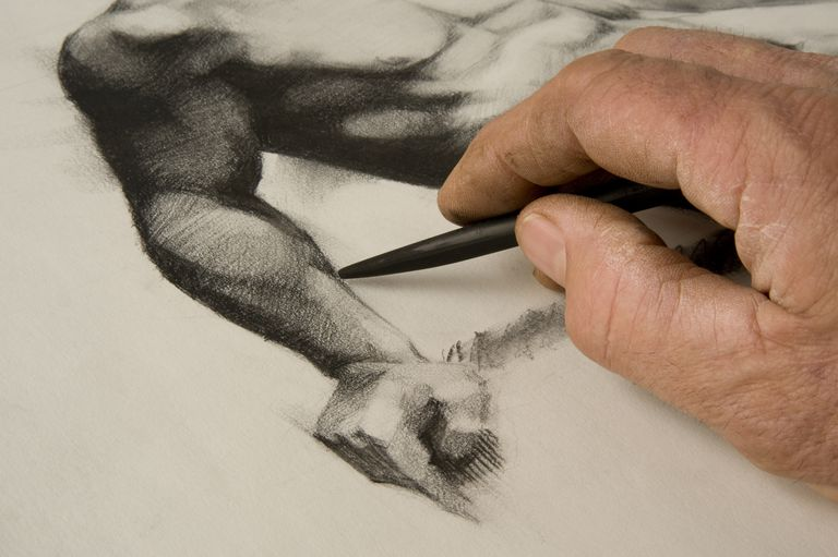Artist's hand and sketches a figure drawing