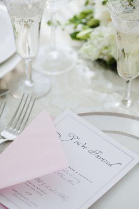 Wedding invitation on table setting, studio shot