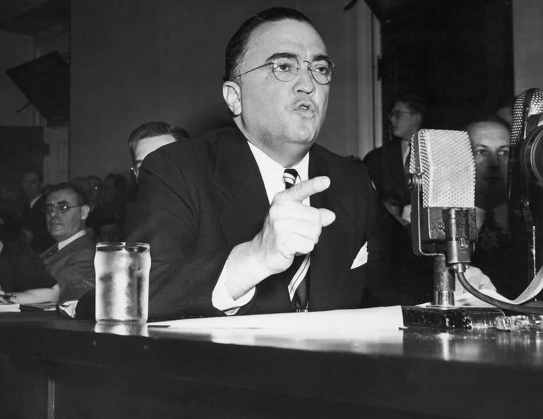 Photograph of J. Edgar Hoover testifying at HUAC hearing.