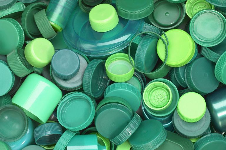 Green plastic lids close up.