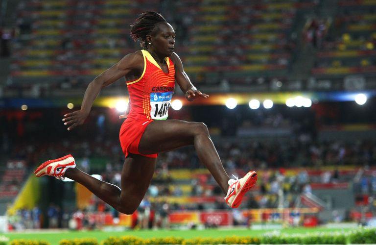Francoise Mbango Etone competes in the triple jump