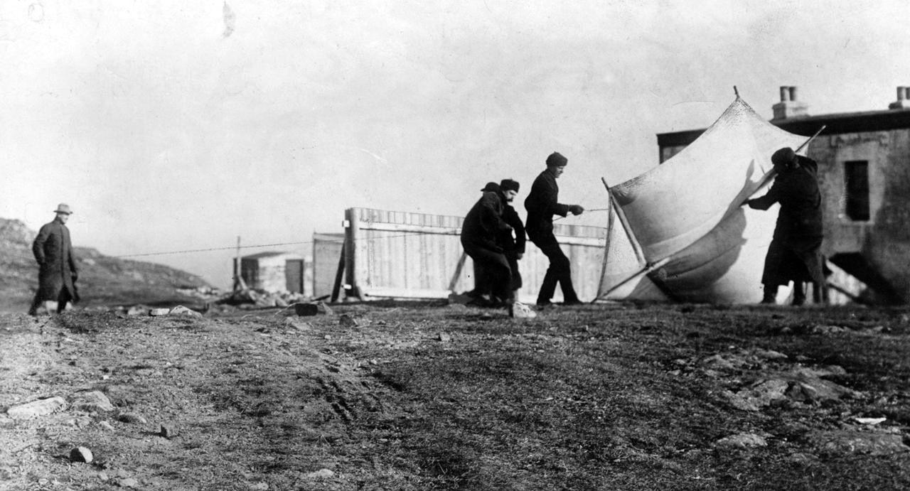 Guglielmo Marconi watching associates raising the kite used to lift the antenna at St. John's, Newfoundland, December 1901