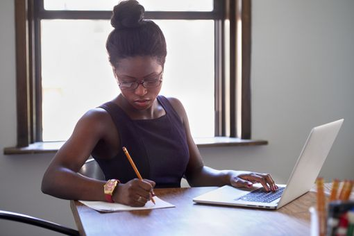 Businesswoman studying for exam