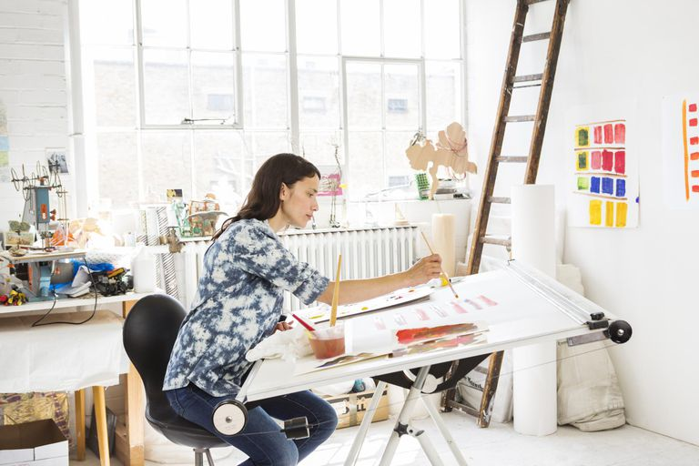 Female artist working in studio