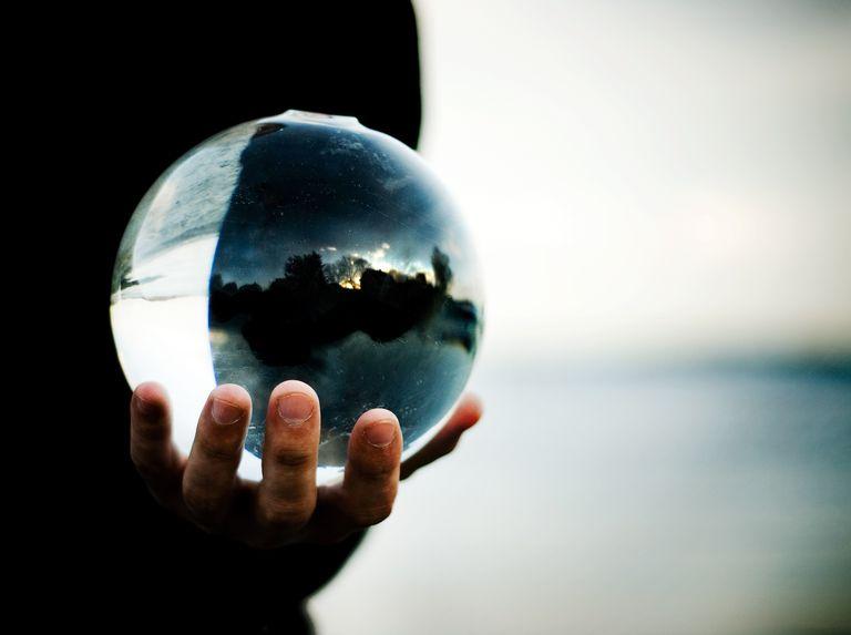 Man holding a glass ball