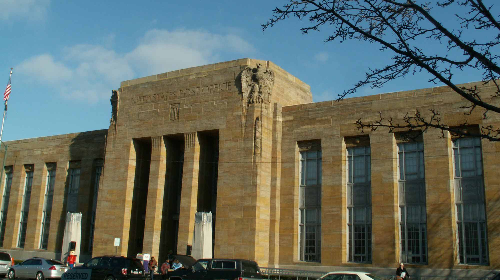 Photo of the Art Deco masonry post office in Springfield, Ohio shows huge eagles near the roof.