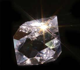 If you rub two pieces of quartz together or crush a quartz crystal, you'll see yellowish-orange triboluminescence.