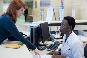 Upset patient explaining problem to medical receptionist.