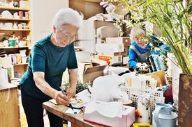 japanese woman busy at work in flower shop
