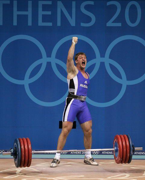 Khadjimourad Akkaev of Russia after clean and jerking 220kg (Silver Medalist; men's 94 kg category)