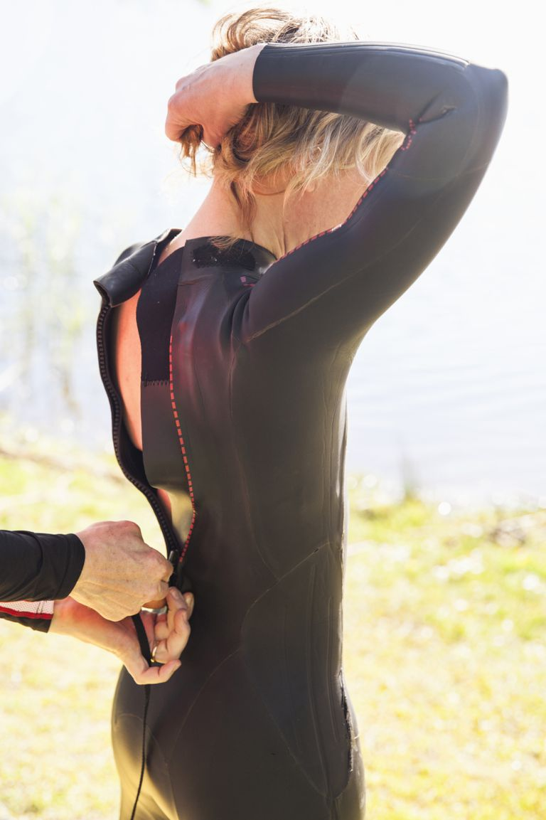 Putting on a wetsuit