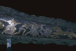 Detail of inlay on a Mycenaean bronze dagger showing a lion hunt, 16th century