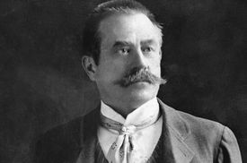 B/w 19th cent. pose, mustacheod architect Stanford White, hands behind back, suit, waistcoat, tie