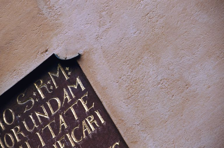 Latin script on wall, low angle view