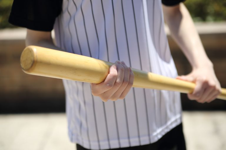 Man Holding A Baseball Bat
