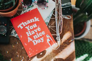 Thank you, Have a nice Day card on table