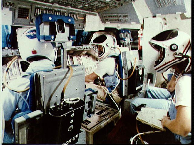 STS-7 crew training in the SMS in seats they will occupy in launch and landing.