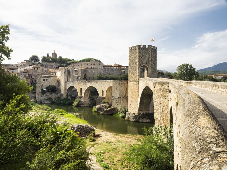 Sight of the people and Besalu medieval bridge to the late afternoon, in the province of Girona, Catalonia, Spain