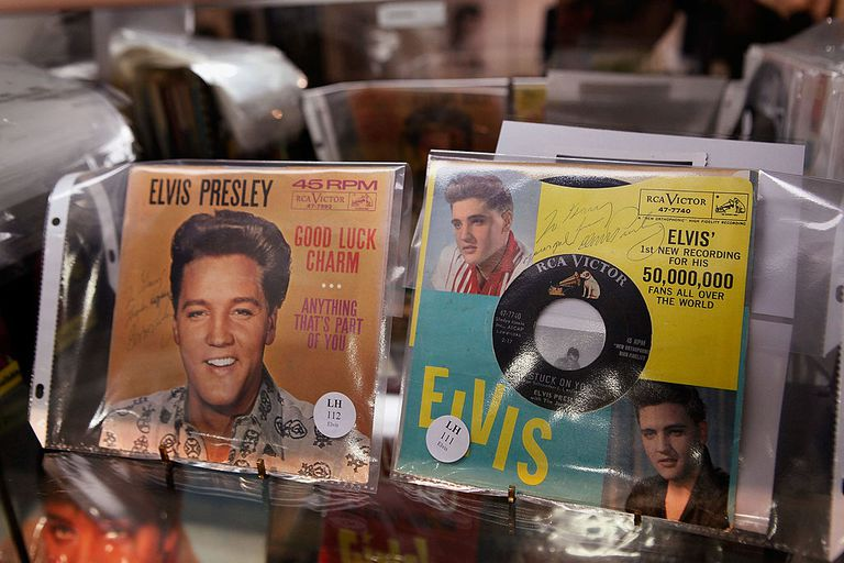 Elvis Presley autographed 45 RPM records are displayed with other Elvis memorabilia at the Leslie Hindman auction house October 15, 2009 in Chicago