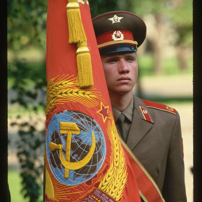 Soviet soldier with Soviet flag