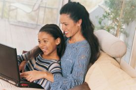 A picture of a mom and child on the computer