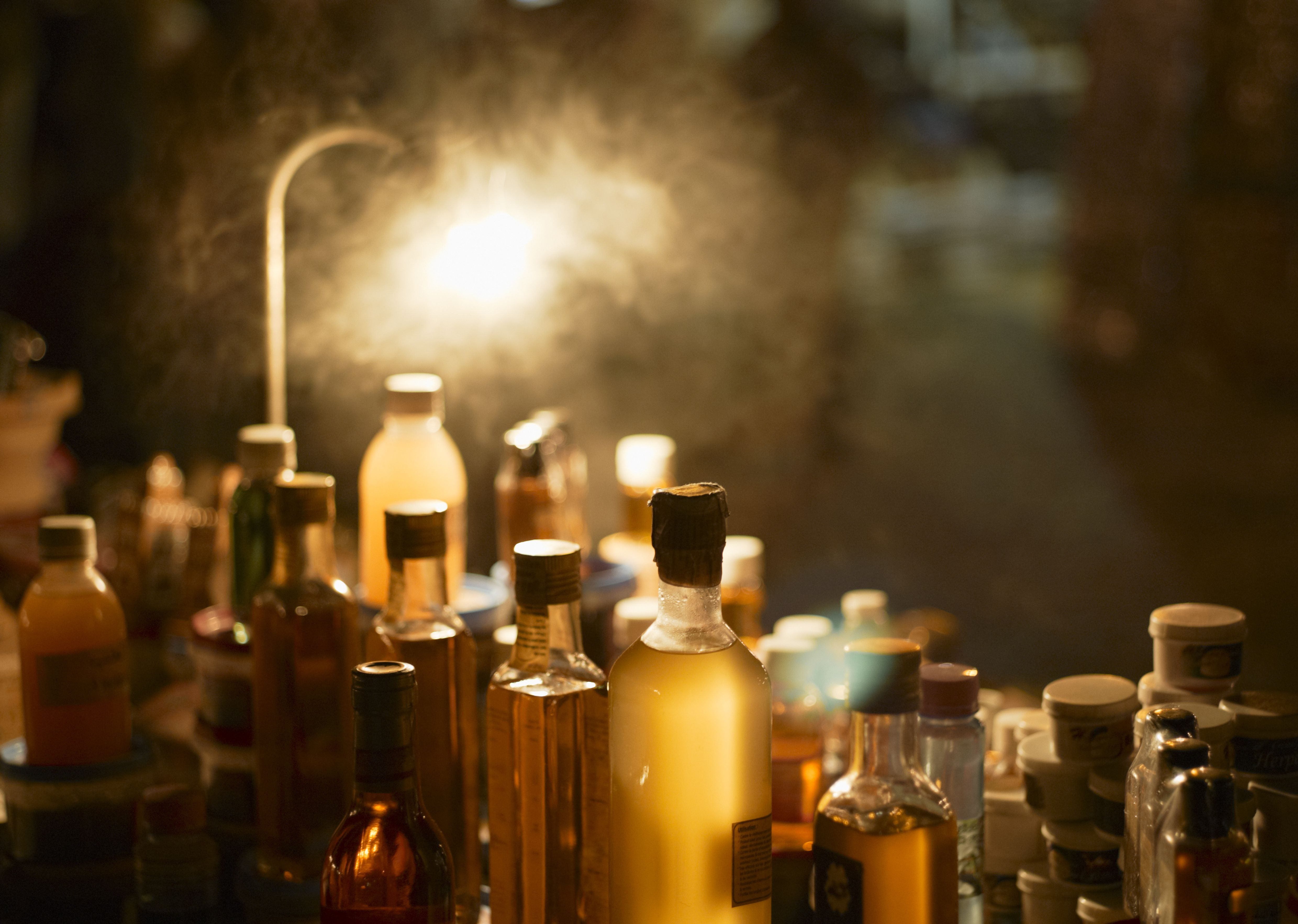Various bottles of oil and essence on market stall