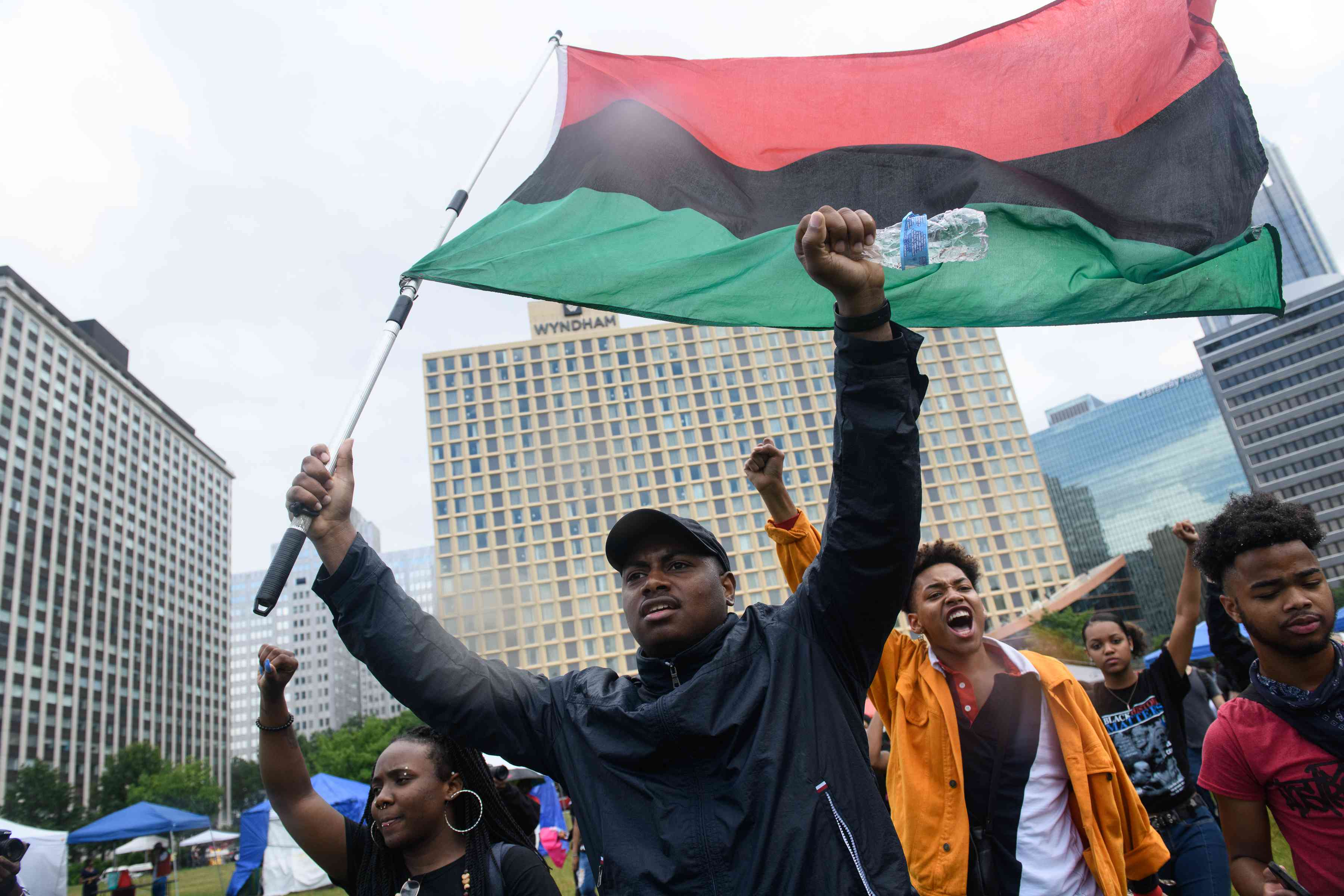 Man in parade holding Juneteenth flag