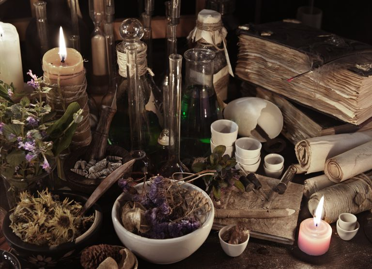 Still life with witch books, scrolls, herbs and magic objects