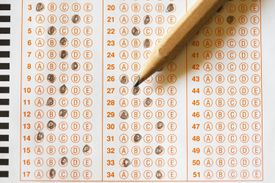 Standardized test with answers bubbled in and a pencil