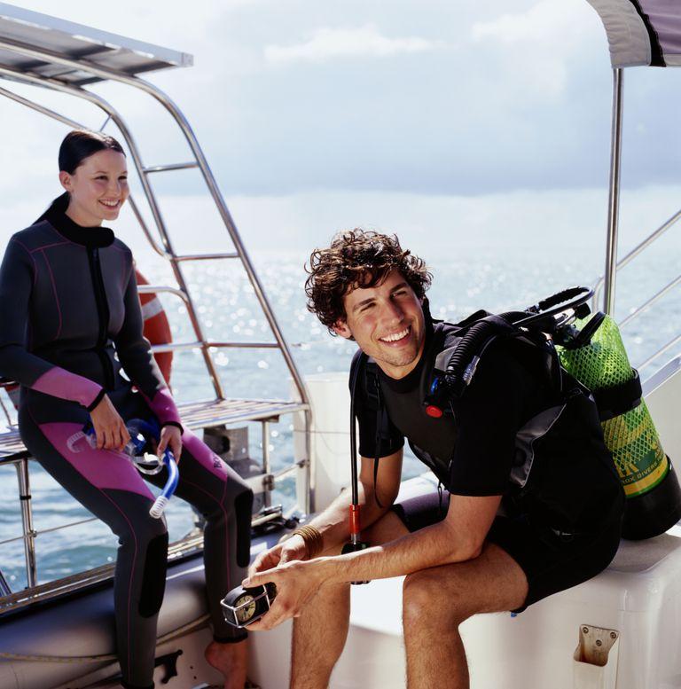 Scuba Divers Prepare for a Dive