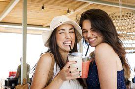 two women enjoying drinks