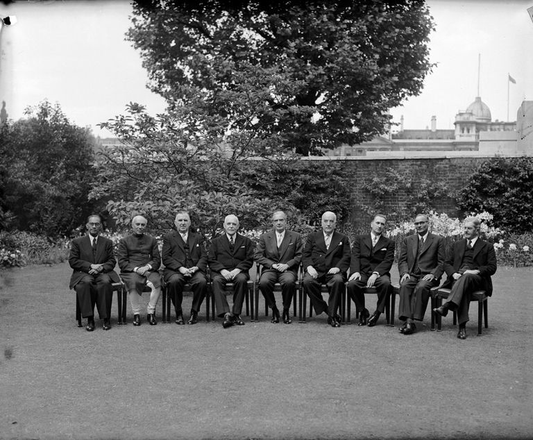 The Commonwealth Group sitting in chairs in a garden.