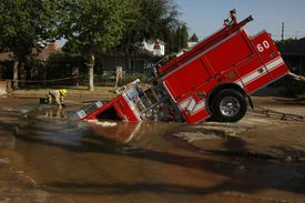 Fire Truck Trapped In Giant Sinkhole