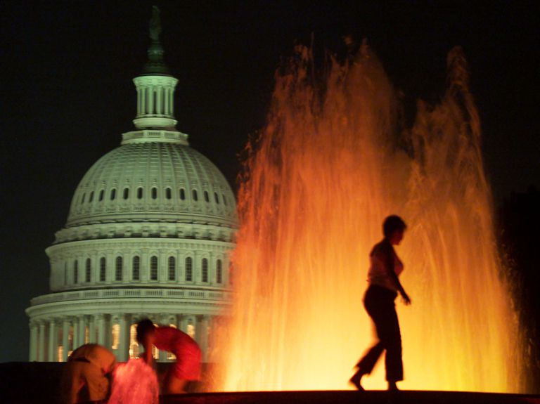 Woman walks on fountain near U.S. Capitol
