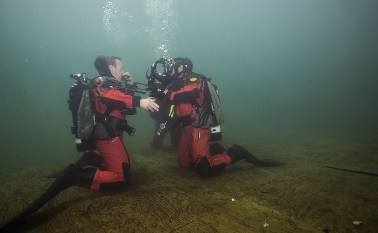 Two divers under the water.