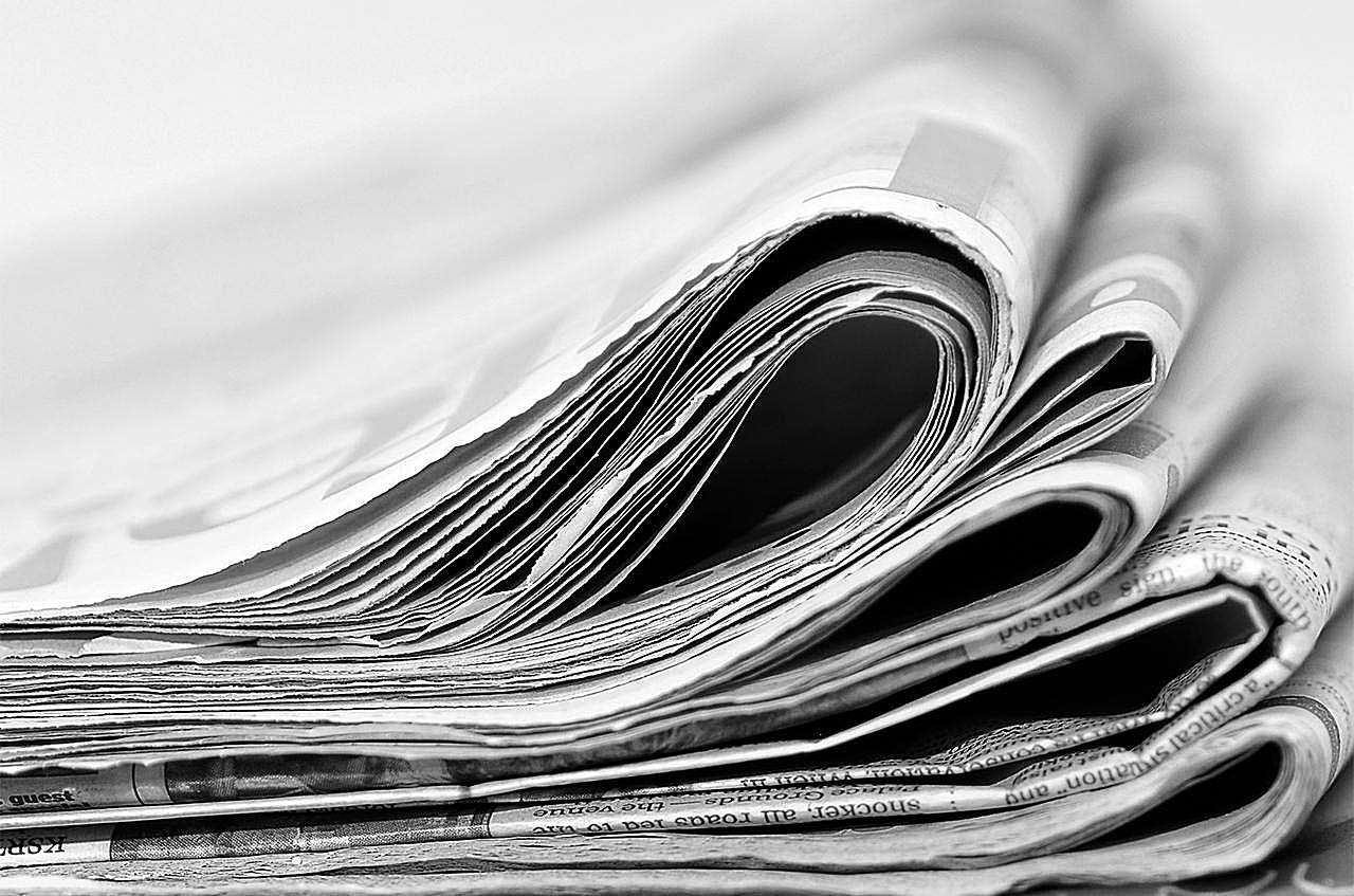 A stack of newspapers, information