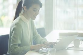 Businesswoman using laptop in conference room