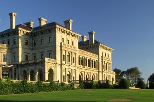 large masonry home, multiple chimneys, opulent neo-Italian Renaissance in style