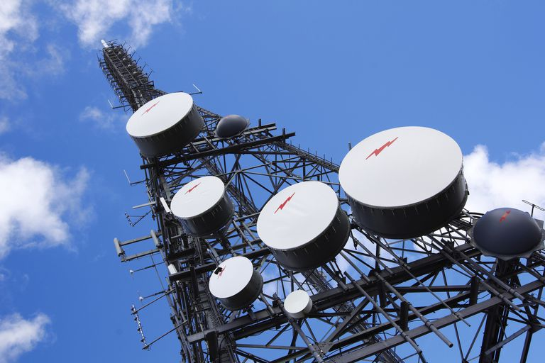 Communications towers send and receive microwave signals.