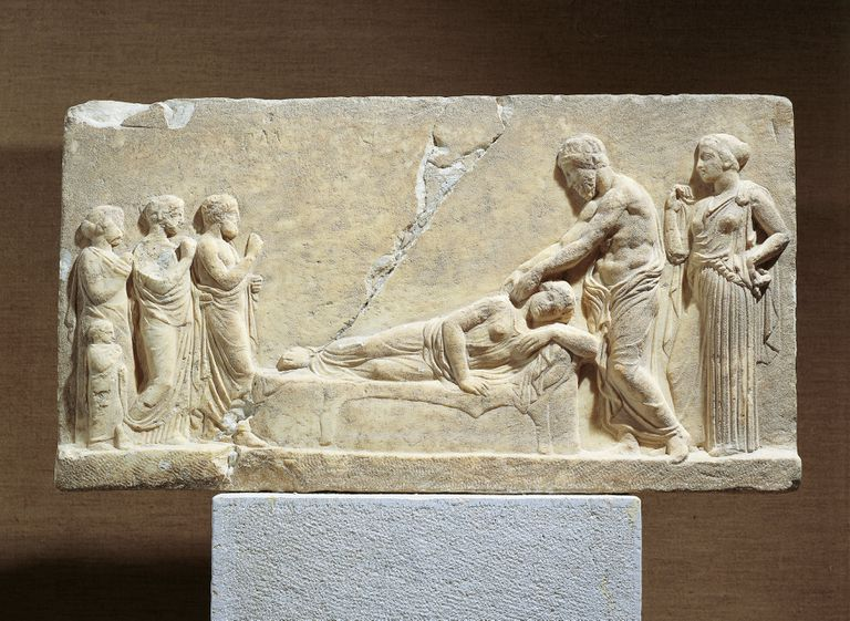 Marble relief of Hippocrates treating ill woman, from Greece