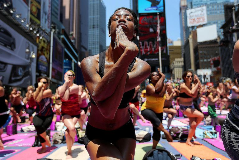 People practicing yoga, based loosely on Buddhist teachings, in multi-cultural New York