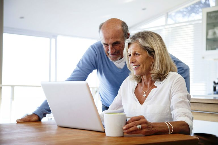 Couple looking at a computer together