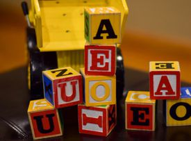 Yellow dump truck with block letters