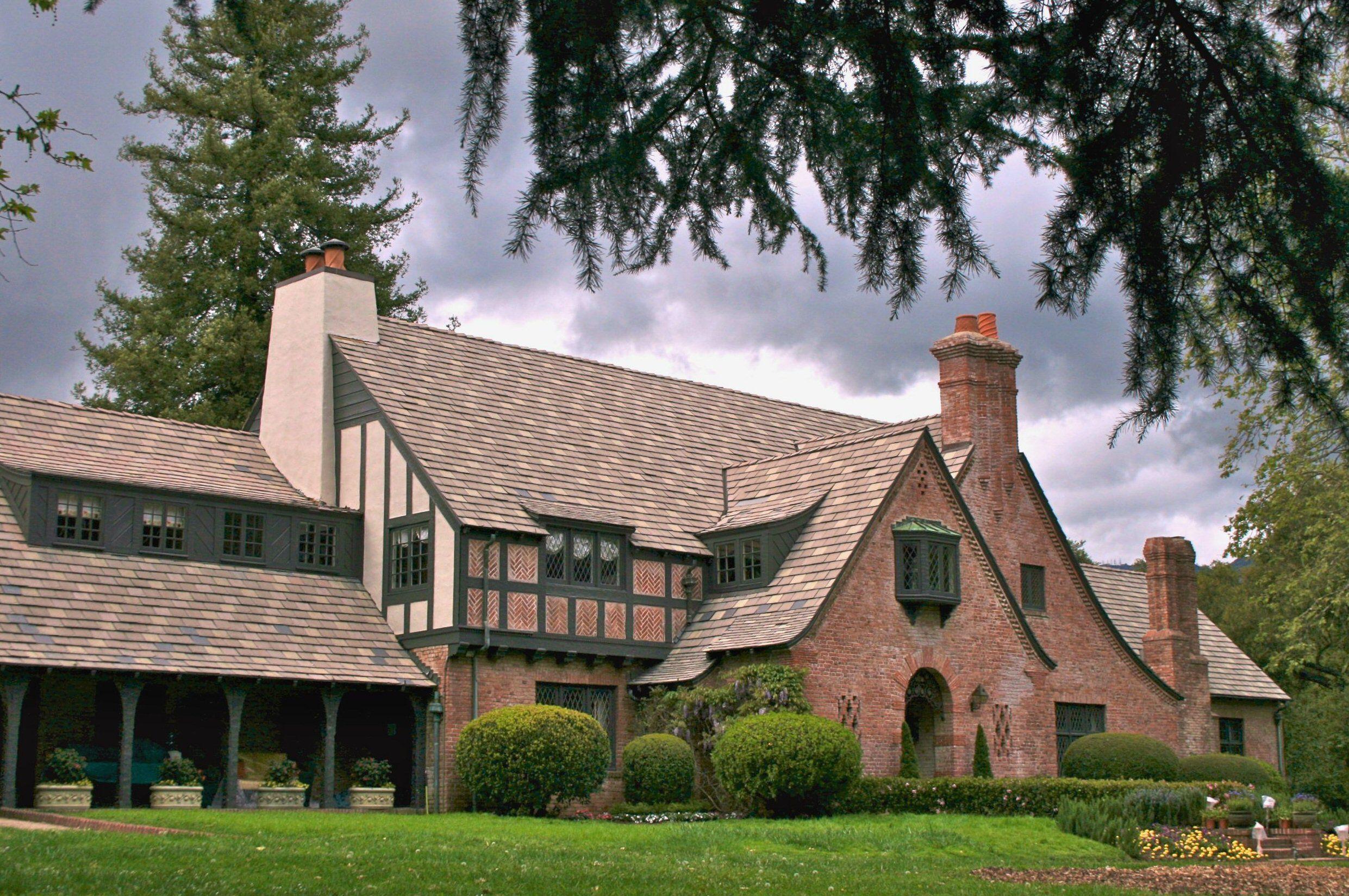 large, brick mansion with English-tudor details